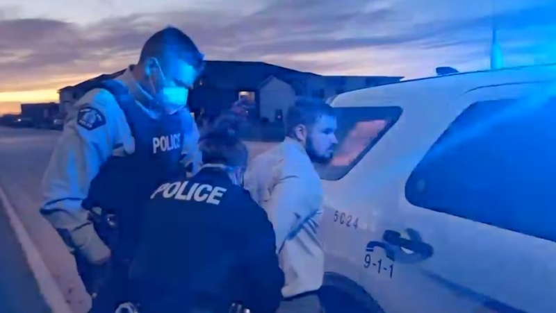 A video posted on social media shows Manitoba RCMP officers arresting Tobias Tissen – the pastor of the Church of God Restoration near Steinbach – on Oct. 18, 2021. RCMP said Tissen was arrested on an outstanding warrant issued for contravening a public health order. (Source: Tobias Tissen/ Facebook)