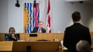 Commissioner Austin Cullen, back centre, listens to introductions before opening statements at the Cullen Commission of Inquiry into Money Laundering in British Columbia, in Vancouver, on Monday, Feb. 24, 2020. (Darryl Dyck / THE CANADIAN PRESS)