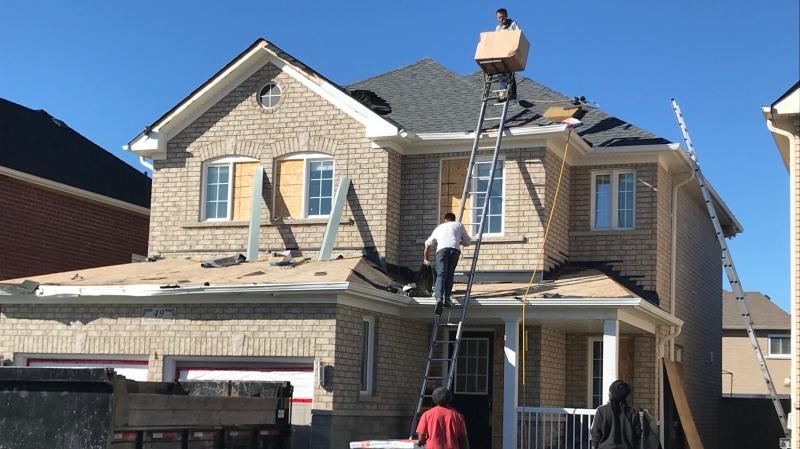 Crews work to rebuilt and restore homes three months after a tornado hit a community in Barrie, Ont., on July 15, 2021 (Rob Cooper/CTV News)