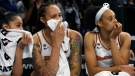 Phoenix Mercury's Sklar Diggins-Smith, left, Brittney Griner, center, and Bria Hartley right, react on the bench during the final seconds of the second half of Game 3 of the WNBA Finals against the Chicago Sky, Friday, Oct. 15, 2021, in Chicago. (AP Photo/Paul Beaty)