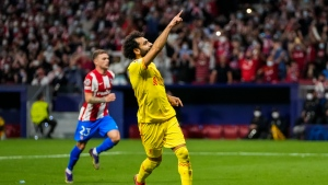 Liverpool's Mohamed Salah celebrates after scoring a penalty during the Champions League Group B soccer match between Atletico Madrid and Liverpool at Wanda Metropolitano stadium in Madrid, Spain, Tuesday, Oct. 19, 2021. (AP Photo/Manu Fernandez)