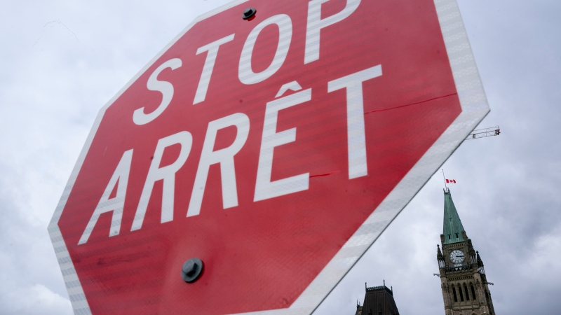 A stop sign is seen on Parliament hill in Ottawa, Monday, Oct. 18. 2021. THE CANADIAN PRESS/Adrian Wyld
