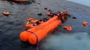 Hundreds of migrants were rescued as their small wooden boat was a sinking in the Mediterranean Sea on Oct. 18.