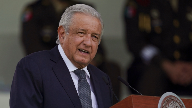 In this Aug. 13, 2021 file photo, Mexican President Andres Manuel Lopez Obrador speaks during a military parade introducing the new army commander in Mexico City.  (AP Photo/Fernando Llano, File)