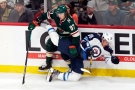 Minnesota Wild's Kirill Kaprizov (97) sends Winnipeg Jets' Nate Schmidt (88) to the ice during the first period of an NHL hockey game Tuesday, Oct. 19, 2021, in St. Paul, Minn. (AP Photo/Jim Mone)