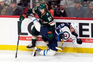 Joel Eriksson Ek had a hat trick for Minnesota, tying the game with 59 seconds remaining in regulation and winning it on a power play in overtime to stun the Winnipeg Jets 6-5 in a raucous home opener for the Wild on Tuesday night.