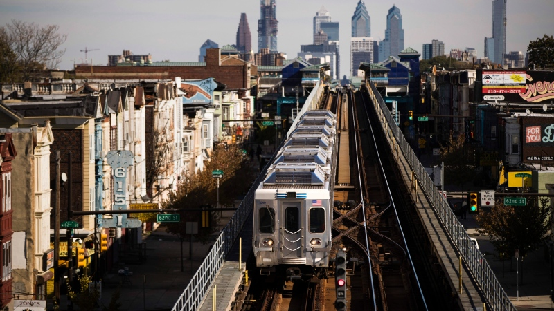 A train moves along the Market-Frankford Line in Philadelphia, Wednesday, Oct. 26, 2016. Transit workers went on strike early Tuesday, Nov. 1, in Philadelphia, shutting down bus, trolley and subways that provide about 900,000 rides a day and raising fears a prolonged walkout could keep some voters from the polls on Election Day. (AP Photo/Matt Rourke)