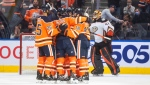 Anaheim Ducks goalie Anthony Stolarz (41) skates past as the Edmonton Oilers celebrate a goal during first period NHL action in Edmonton on Tuesday, October 19, 2021. (THE CANADIAN PRESS/Jason Franson)