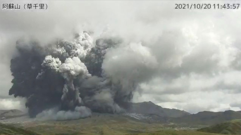 In this image taken by a surveillance camera released by Japan Meteorological Agency, smokes rise from the No. 1 Nakadake crater of Mr. Aso after its eruption, observed from Kusasenri, southwestern Japan, Wednesday, Oct. 20, 2021. (Japan Meteorological Agency via AP)