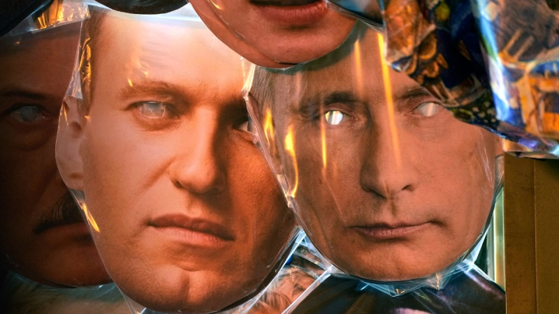 Face masks depicting Russian President Vladimir Putin, right, and jailed Russian opposition leader Alexei Navalny, left, displayed for sale in St. Petersburg, Russia, on Sept. 8, 2021. (Dmitri Lovetsky / AP)