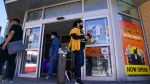 Customers walk out of the Spirit of Halloween store in Toronto on Tuesday, October 19, 2021. The global supply chain is continuing to be affected by COVID-19. THE CANADIAN PRESS/Evan Buhler