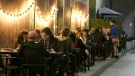 People enjoying a restaurant meal after the government lifted some virus restrictions and allowed food establishments to open to 50% of their indoor capacity in Warsaw, Poland, on Friday, May 28, 2021. (AP Photo/Czarek Sokolowski)