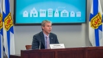 Nova Scotia Premier Tim Houston delivers his housing plan in Halifax on Wednesday, Oct. 20, 2021. Houston announced that rent control will continue until Dec. 31, 2023 as a housing crisis continues across the province. THE CANADIAN PRESS/Andrew Vaughan