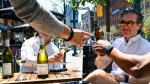 People enjoy drinks and friends on outdoor patios during the COVID-19 pandemic in downtown Toronto on Friday, June 11, 2021. THE CANADIAN PRESS/Nathan Denette