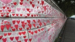 Hearts and messages form the National COVID Memorial Wall on the South Bank in front of St Thomas' Hospital in London, on Oct. 19, 2021.  (Tony Hicks / AP)
