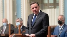 Quebec Premier Francois Legault presents the inaugural speech, Tuesday Oct. 19, 2021 at the legislature in Quebec City. THE CANADIAN PRESS/Jacques Boissinot