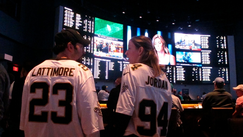 In this Sept. 9, 2018, file photo, football fans wait for kickoff in the sports betting lounge at the Ocean Casino Resort in Atlantic City, N.J. (AP Photo/Wayne Parry, File)