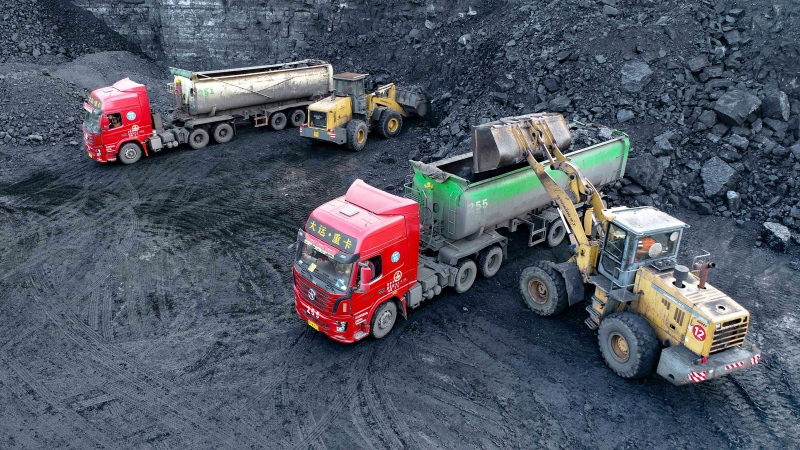 A loader loads coal for transport vehicles at an open-pit coal mine in Ejin Horo Banner, Ordos City, Inner Mongolia, China, Oct. 19, 2021. (Wang Zheng/Costfoto/Barcroft Media/Getty Images/CNN)