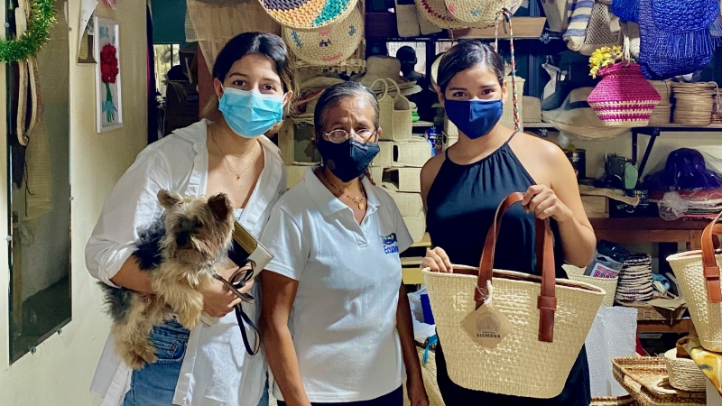 Yunta Festival organizers Celeste Nunez (left) and Yulissa Campos (right) with an artisan from Ecuador who will be selling her products on Saturday.