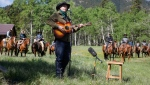 Singer Corb Lund, centre, sings on land proposed for coal mine development in the eastern slopes of the Livingstone range south west of Longview, Alta., Wednesday, June 16, 2021. (THE CANADIAN PRESS/Jeff McIntosh)