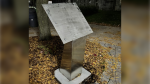 Kingston police are investigating after a commemorative plaque and metal booklet about a military company from Queen's University went missing the weekend of Oct. 16-17, 2021. (Submitted by Kingston Police Service)