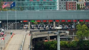 A vehicle crosses the International Rainbow Bridge from Niagara Falls, Ont. into Niagara Falls, N.Y. on Wednesday, October 13, 2021. (THE CANADIAN PRESS / Aaron Lynett)