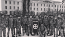A photo posted in 2019 to Centuria's Telegram shows a group of uniformed men posing next to one of the buildings of the Ukrainian National Army Academy. The building is part of the NAA's campus in Lviv. It is possible that Centuria's manipulation of the original photo included a modification that changed the banner in the resulting image to feature a Sonnenkreuz as opposed to a symbol reminiscent of crosshairs on a target, according to the report. (Oleksiy Kuzmenko/George Washington University IEREs/Military Order Centuria/Telegram)