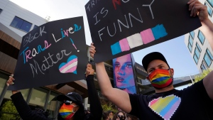 People protest outside the Netflix building on Vine Street in the Hollywood section of Los Angeles, Wednesday, Oct. 20, 2021. (AP Photo/Damian Dovarganes)