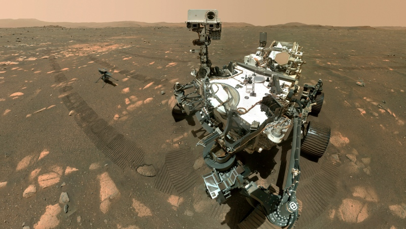 This April 6, 2021, image made available by NASA shows the Perseverance Mars rover and the Ingenuity helicopter about four metres behind. This composite image was made by the WASTON camera on the rover's robotic arm on the 46th Martian day, or sol, of the mission. (NASA/JPL-Caltech/MSSS via AP)