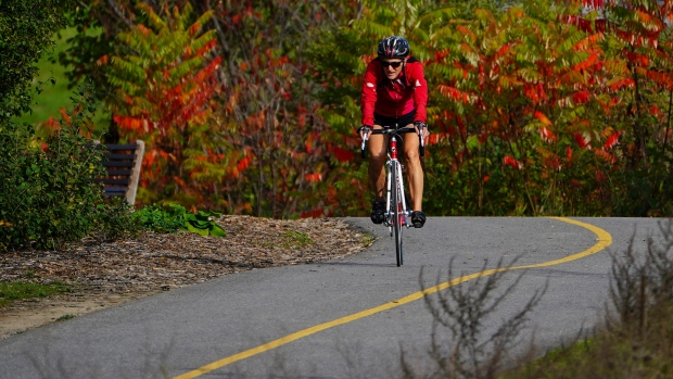 A cyclist makes their way along the banks of the Ottawa River in Ottawa on Wednesday, Oct. 20, 2021. (Sean Kilpatrick/THE CANADIAN PRESS)