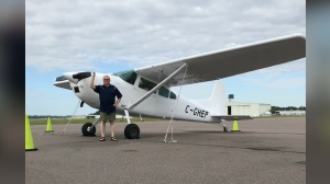 Roland Jenson with the Cessna 185 he refurbished and sold to a London, England production company, buying the float plane for the next James Bond movie released in October. (Photo courtesy of Roland Jenson)