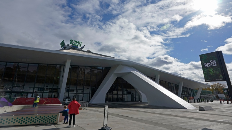 The sun shines above Climate Pledge Arena, Wednesday, Oct. 20, 2021, ahead of the NHL hockey Seattle Kraken's home opener Saturday against the Vancouver Canucks in Seattle. (AP Photo/Ted S. Warren)