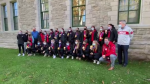 Canada's women's soccer team poses for a picture with Mayor Jim Watson and coun. Mathieu Fleury at Ottawa City Hall. (Tyler Fleming/CTV News Ottawa)