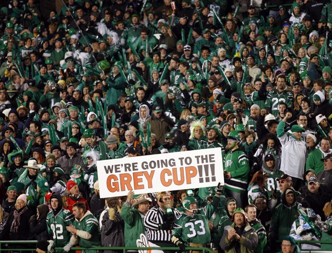 Saskatchewan Roughriders fans celebrate after their team defeated the Calgary Stampeders in the CFL Western final in Regina, Sunday, Nov. 22, 2009. (Jeff McIntosh / THE CANADIAN PRESS)