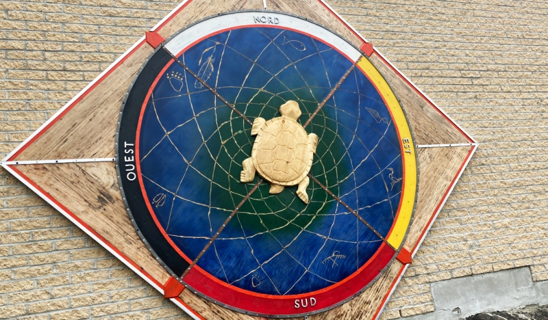 On Wednesday, Anishinaabe Ojibway artist Will Morin unveiled the compass dream catcher medicine wheel he was commissioned to create for College Boreal. (Alana Everson/CTV News)