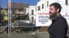 Daniel Snow watches as his former home, the El Mirador apartments, is torn down on Oct. 20, 2021(Matt Marshall/CTV News Edmonton).