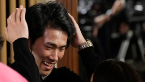 -Pianist Bruce (Xiaoyu) Liu of Canada reacts after being named as the winner of the 40,000-euro (US$45,000) first prize in the 18th Frederic Chopin international piano competition, a prestigious event that launches pianists' world careers. (AP Photo/Czarek Sokolowski)