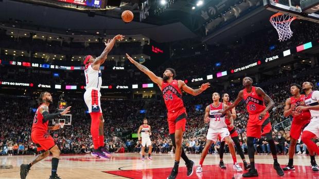 Washington Wizards guard Bradley Beal (3) shoots under pressure from Toronto Raptors centre Khem Birch (24) during second half NBA action in Toronto Wednesday, October 20, 2021. THE CANADIAN PRESS/Evan Buhler
