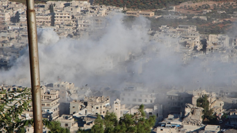 Smoke rises after Syrian government shelling on the northern town of Ariha, in Idlib province, Syria, on Oct. 20, 2021.  (Syrian Civil Defence White Helmets via AP)