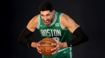 Boston Celtics centre Enes Kanter yells for a photo during the Boston Celtics Media Day, on Sept. 27, 2021. (Mary Schwalm / AP)