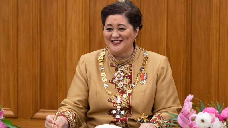 New Zealand Governor-General Dame Cindy Kiro signs a visitor's book after her official swearing-in ceremony (Mark Mitchell/New Zealand Herald via AP)