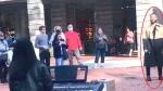 John Legend stops to watch street performer sing h
