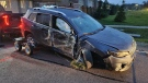 A smashed up vehicle is hooked up to a tow truck in Caledon, Ont., on Thurs., Oct. 21, 2021 (OPP_CR)