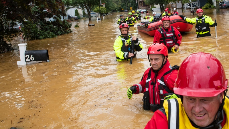 Members of the New Market Volunteer Fire Company are shown here during an evacuation effort following a flash flood in Helmetta, New Jersey, on Aug. 22, 2021. (Tom Brenner/AFP/Getty Images via CNN)