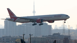 Air India flight 187 from New Delhi lands at Pearson Airport in Toronto on Friday, April 23, 2021. The flight was the last landing allowed after all flights from India and Pakistan to Canada were suspended. THE CANADIAN PRESS/Frank Gunn