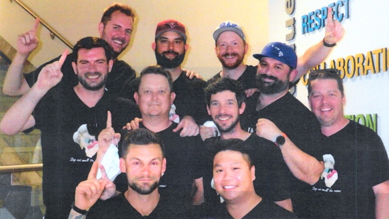 These ten Calgary men won $1 million in from a winning Lotto Max ticket. (Western Canada Lottery Corporation)