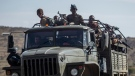 In this Saturday, May 8, 2021 file photo, Ethiopian government soldiers ride in the back of a truck on a road near Agula, north of Mekele, in the Tigray region of northern Ethiopia. (AP Photo/Ben Curtis, File)
