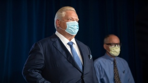 Ontario Premier Doug Ford (left) stands alongside Dr. Kieran Moore, the Chief Medical Officer of Health of Ontario, during a press briefing at the Queens Park Legislature in Toronto, on Friday, October 15, 2021. THE CANADIAN PRESS/Chris Young