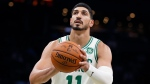 In this Sunday, Oct. 6, 2019 file photo, Boston Celtics' Enes Kanter plays against the Charlotte Hornets during the first half of a preseason NBA basketball game in Boston. (AP Photo/Michael Dwyer)