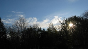 Wispy clouds with sun peaking through in Morden. Photo by Betty Warkentin.